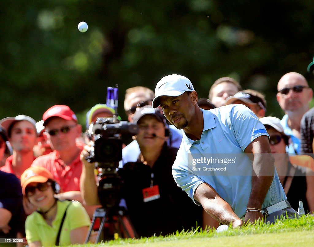 Tiger Woods chips onto the 13th green during the Third Round of the World Golf Championships-Bridgestone Invitational at Firestone Country Club South Course on August 3, 2013 in Akron, Ohio.