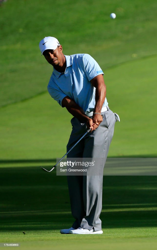<a gi-track='captionPersonalityLinkClicked' href=/galleries/search?phrase=Tiger+Woods&family=editorial&specificpeople=157537 ng-click='$event.stopPropagation()'>Tiger Woods</a> chips onto the 18th green during the Third Round of the World Golf Championships-Bridgestone Invitational at Firestone Country Club South Course on August 3, 2013 in Akron, Ohio.