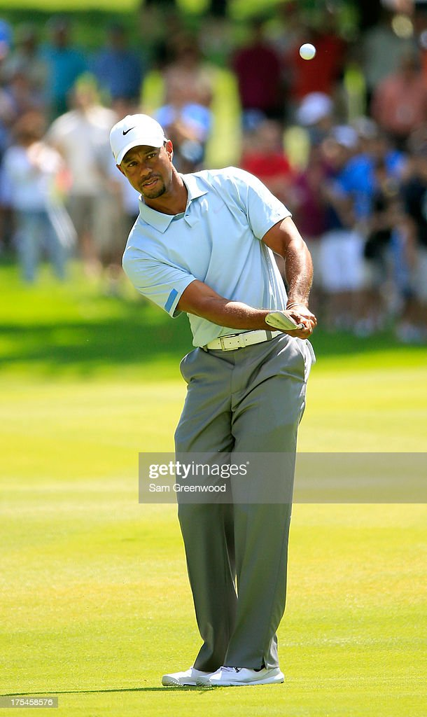 Tiger Woods chips onto the eighth green during the Third Round of the World Golf Championships-Bridgestone Invitational at Firestone Country Club South Course on August 3, 2013 in Akron, Ohio.