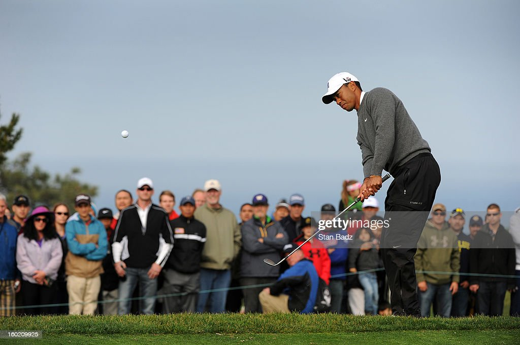 <a gi-track='captionPersonalityLinkClicked' href=/galleries/search?phrase=Tiger+Woods&family=editorial&specificpeople=157537 ng-click='$event.stopPropagation()'>Tiger Woods</a> chips onto the fifth green during the third round of the Farmers Insurance Open at Torrey Pines Golf Course on January 27, 2013 in La Jolla, California.