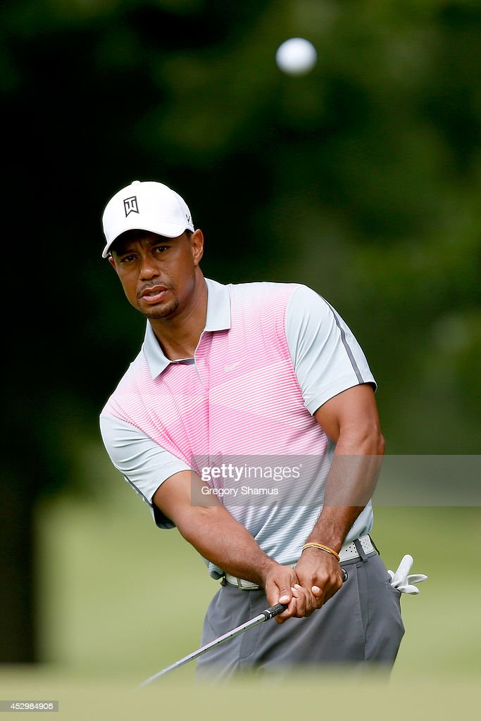 Tiger Woods chips onto the fourth green during the first round of the World Golf Championships-Bridgestone Invitational at Firestone Country Club South Course on July 31, 2014 in Akron, Ohio.