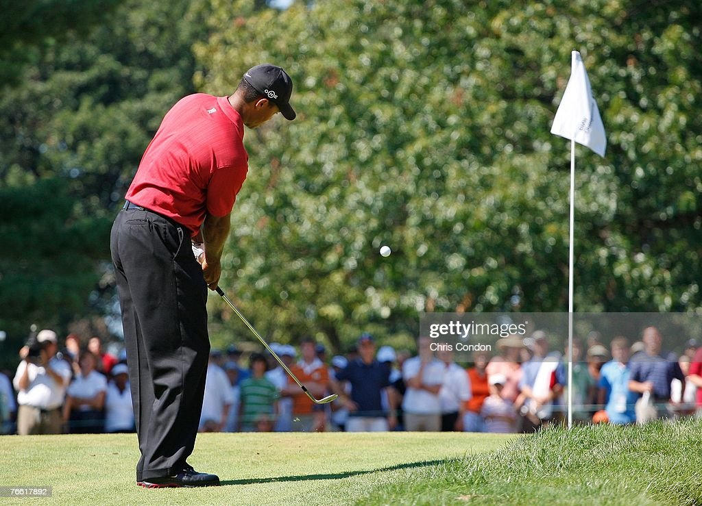 Tiger Woods chips to the 6th green during the final round of BMW Championship the third event of the new PGA TOUR Playoffs for the FedExCup at Cog...