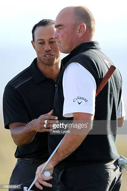 Tiger Woods congratulates Thomas Bjorn of Denmark on his win on the 19th hole during the first round of the Accenture Match Play Championship at the...