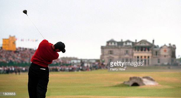 Tiger Woods drives off the 18th green on his way to a victory in the British Open Championships at the Old Course St Andrews Scotland July 23 2000