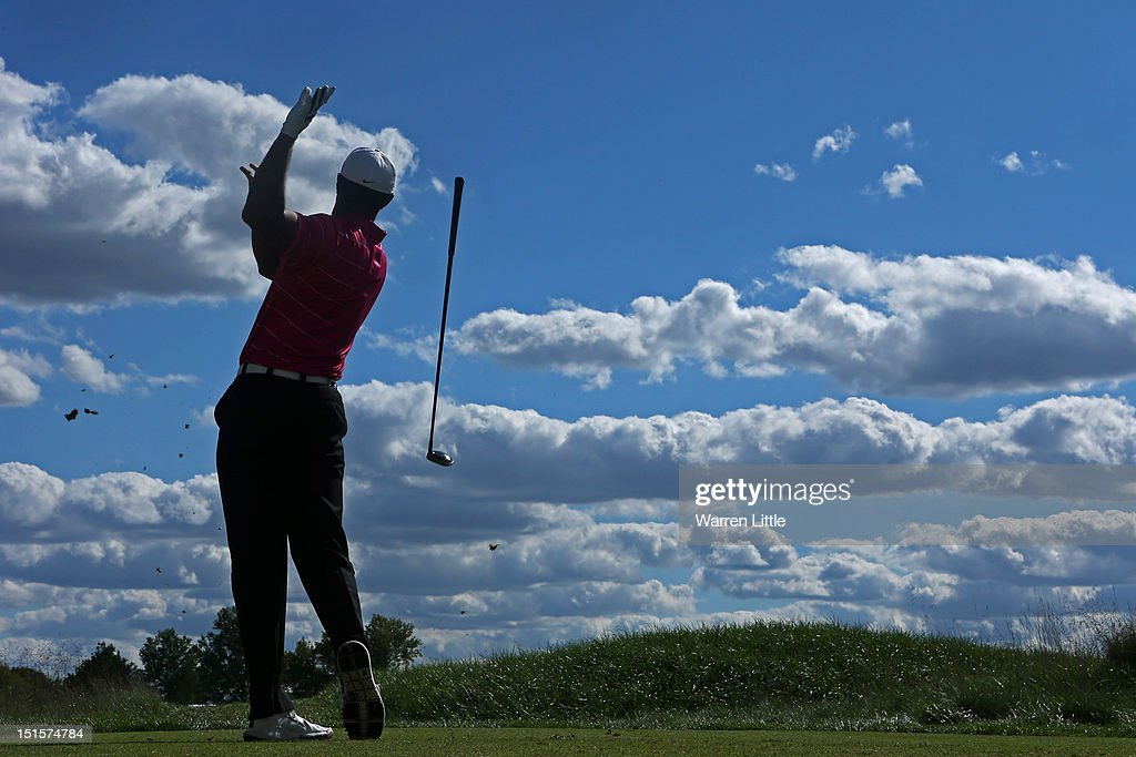 <a gi-track='captionPersonalityLinkClicked' href=/galleries/search?phrase=Tiger+Woods&family=editorial&specificpeople=157537 ng-click='$event.stopPropagation()'>Tiger Woods</a> drops his club as he watches his tee shot on the tenth hole during the third round of the BMW Championship at Crooked Stick Golf Club on September 8, 2012 in Carmel, Indiana.