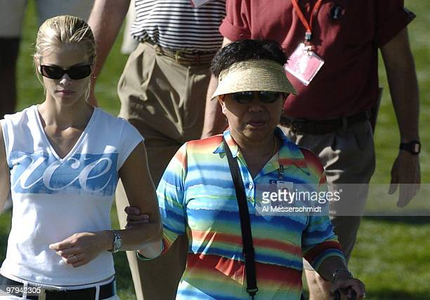 Tiger Woods fiancee Elin Nordegren and mother Kutilda Woods walk arminarm during the second round of the PGA Tour Bay Hill Invitational March 19...