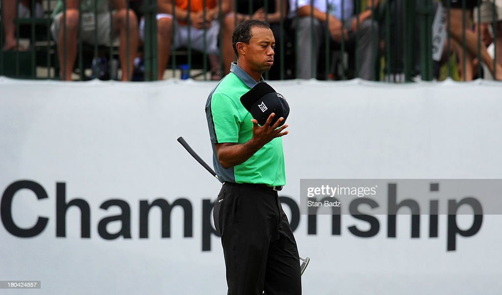 Tiger Woods finishes his first round of play on the ninth hole during the BMW Championship at Conway Farms Golf Club on September 12, 2013 in Lake Forest, Illinois.