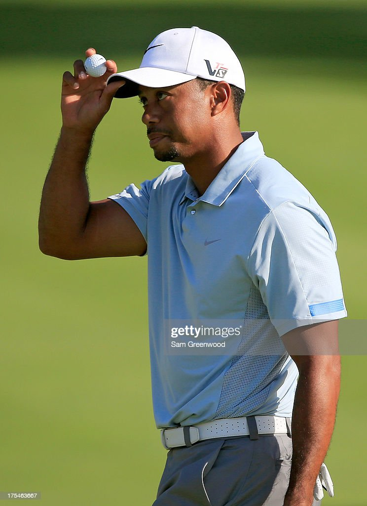 Tiger Woods gestures after finishing the 18th hole during the Third Round of the World Golf Championships-Bridgestone Invitational at Firestone Country Club South Course on August 3, 2013 in Akron, Ohio.