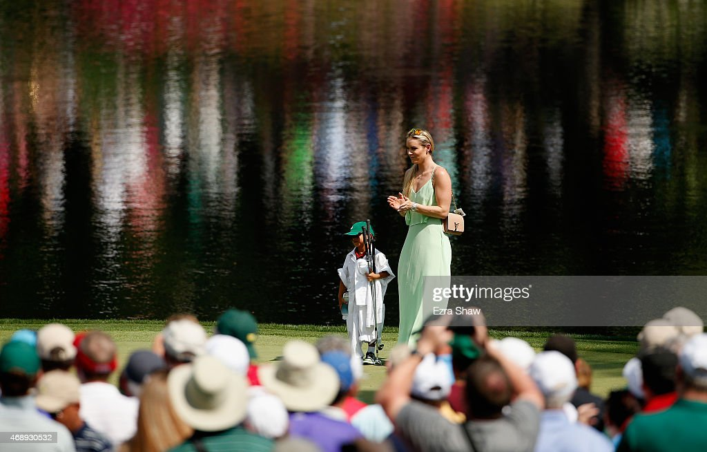 Tiger Woods' girlfriend Lindsey Vonn waits on a green with his son Charlie during the Par 3 Contest prior to the start of the 2015 Masters Tournament at Augusta National Golf Club on April 8, 2015 in Augusta, Georgia.