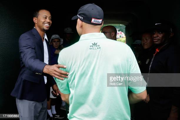 Tiger Woods greets Bill Haas after he won the ATT National at Congressional Country Club on June 30 2013 in Bethesda Maryland