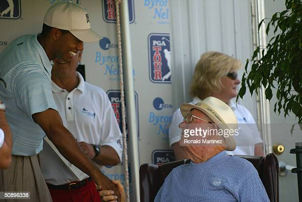 Tiger Woods greets Byron Nelson during the third round of the EDS Byron Nelson Championship on May 15 2004 at the TPC Las Colinas in Irving Texas