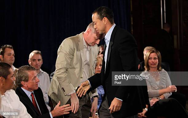 Tiger Woods greets Notah Begay III PGA Commissioner Tim Finchem and Rob McNamara at the Sunset Room on the second floor of the TPC Sawgrass home of...