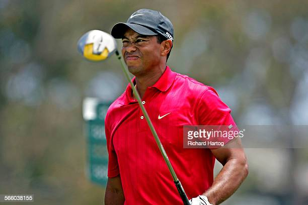 Tiger Woods grimaces in obvious pain after teeing off on the eighteenth hole during the playoff of the US Open at Torrey Pines in La Jolla of June 16...