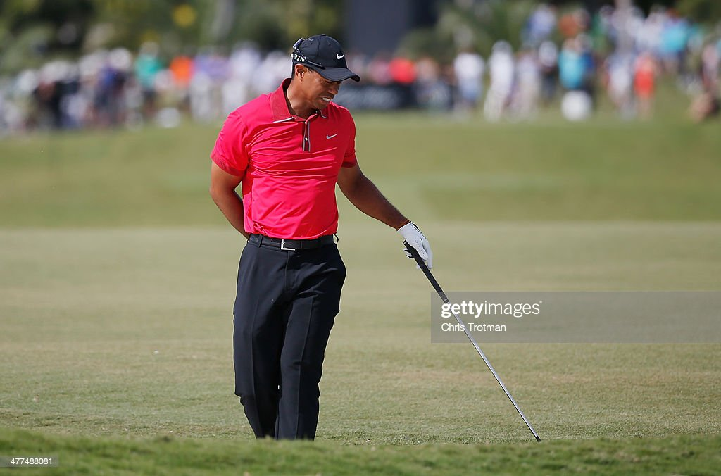 <a gi-track='captionPersonalityLinkClicked' href=/galleries/search?phrase=Tiger+Woods&family=editorial&specificpeople=157537 ng-click='$event.stopPropagation()'>Tiger Woods</a> grimages after playing a bunker shot on the fifth hole during the final round of the World Golf Championships-Cadillac Championship at Trump National Doral on March 9, 2014 in Doral, Florida.