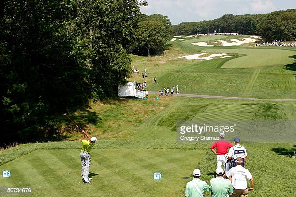 Tiger Woods hit a tee shot on the fourth hole during the third round of The Barclays at the Black Course at Bethpage State Park August 25 2012 in...