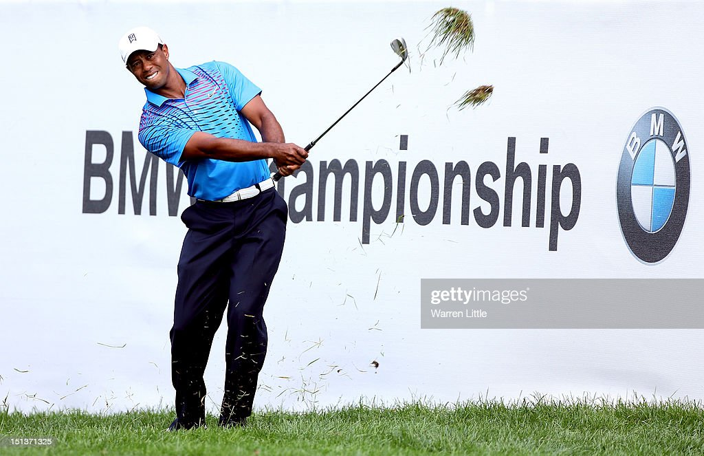 <a gi-track='captionPersonalityLinkClicked' href=/galleries/search?phrase=Tiger+Woods&family=editorial&specificpeople=157537 ng-click='$event.stopPropagation()'>Tiger Woods</a> hits a chip shot on to the green on the ninth hole during the first round of the BMW Championship at Crooked Stick Golf Club on September 6, 2012 in Carmel, Indiana.