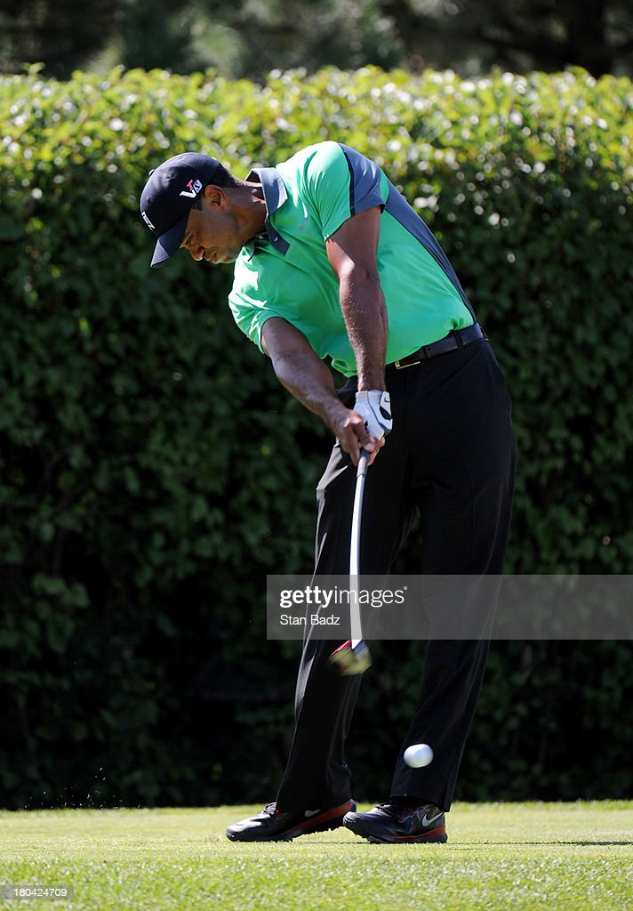 Tiger Woods hits a drive on the 13th hole during the first round of the BMW Championship at Conway Farms Golf Club on September 12, 2013 in Lake Forest, Illinois.