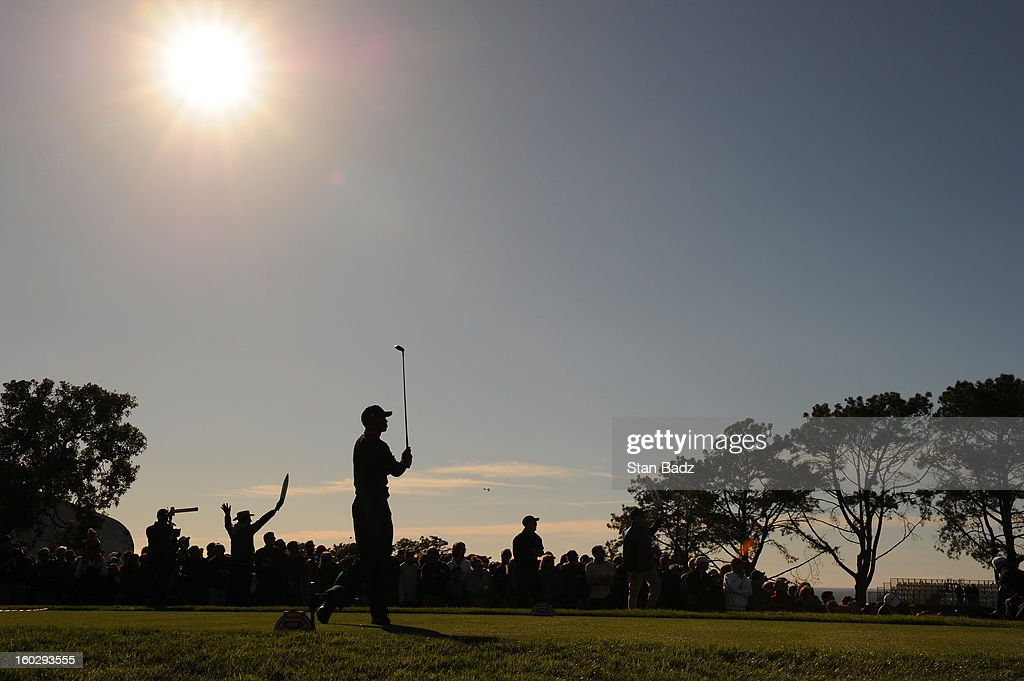 Tiger Woods hits a drive on the 18th hole during the final round of the Farmers Insurance Open at Torrey Pines Golf Course on January 28, 2013 in La Jolla, California.