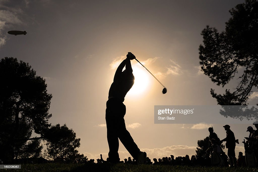 Tiger Woods hits a drive on the second hole during the final round of the Farmers Insurance Open at Torrey Pines Golf Course on January 27, 2013 in La Jolla, California.
