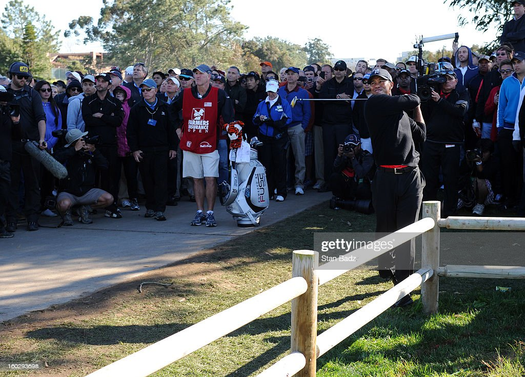 Tiger Woods hits a shot to the 15th green during the final round of the Farmers Insurance Open at Torrey Pines Golf Course on January 28, 2013 in La Jolla, California.