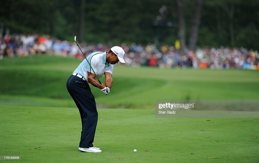 <a gi-track='captionPersonalityLinkClicked' href=/galleries/search?phrase=Tiger+Woods&family=editorial&specificpeople=157537 ng-click='$event.stopPropagation()'>Tiger Woods</a> hits a shot to the sixth green during the second round of the Deutsche Bank Championship at TPC Boston on August 31, 2013 in Norton, Massachusetts.