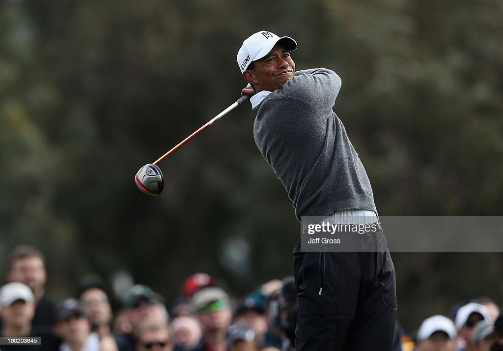 Tiger Woods hits a tee shot on the 12th hole during the third round of the Farmers Insurance Open at at Torrey Pines South Golf Course on January 27, 2013 in La Jolla, California.