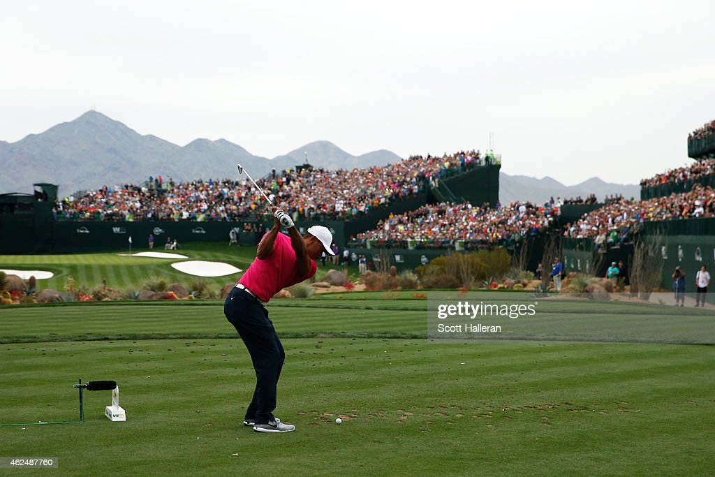 Tiger Woods hits a tee shot on the 16th hole during the first round of the Waste Management Phoenix Open at TPC Scottsdale on January 29 2015 in...