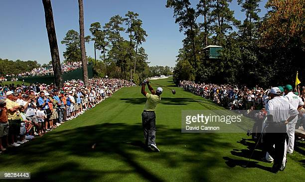 Tiger Woods hits a tee shot on the 18th hole as Mark O'Meara looks on during a practice round prior to the 2010 Masters Tournament at Augusta...