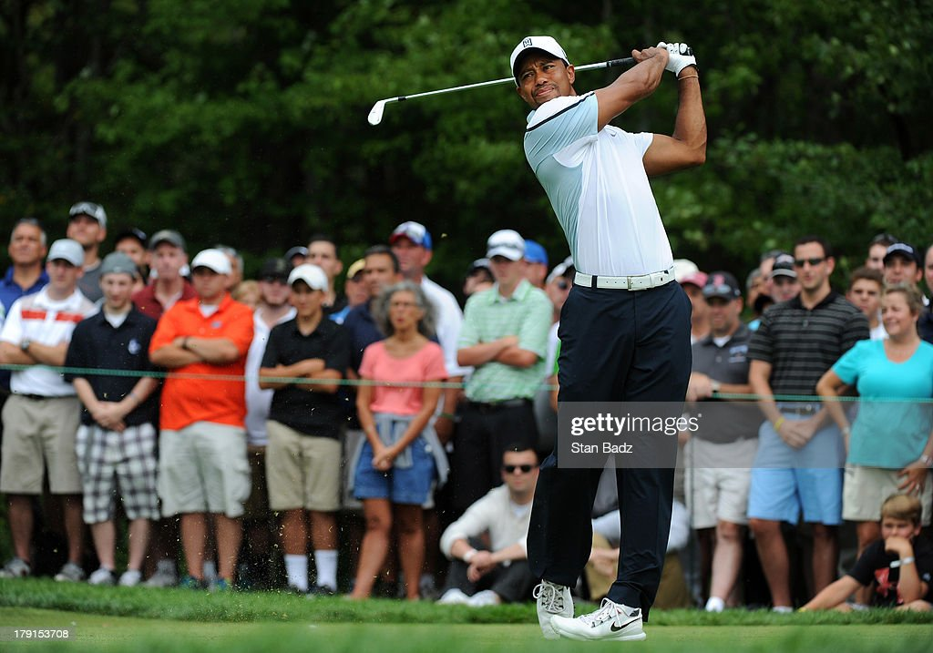 <a gi-track='captionPersonalityLinkClicked' href=/galleries/search?phrase=Tiger+Woods&family=editorial&specificpeople=157537 ng-click='$event.stopPropagation()'>Tiger Woods</a> hits a tee shot on the first hole during the second round of the Deutsche Bank Championship at TPC Boston on August 31, 2013 in Norton, Massachusetts.