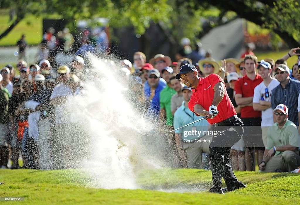 <a gi-track='captionPersonalityLinkClicked' href=/galleries/search?phrase=Tiger+Woods&family=editorial&specificpeople=157537 ng-click='$event.stopPropagation()'>Tiger Woods</a> hits from a bunker on the 12th hole during the final round of the World Golf Championships-Cadillac Championship at TPC Blue Monster at Doral on March 10, 2013 in Doral, Florida.