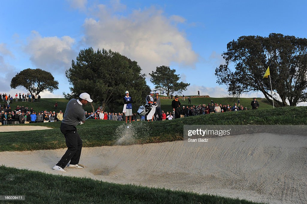 Tiger Woods hits from a bunker on the fifth hole during the final round of the Farmers Insurance Open at Torrey Pines Golf Course on January 27, 2013 in La Jolla, California.