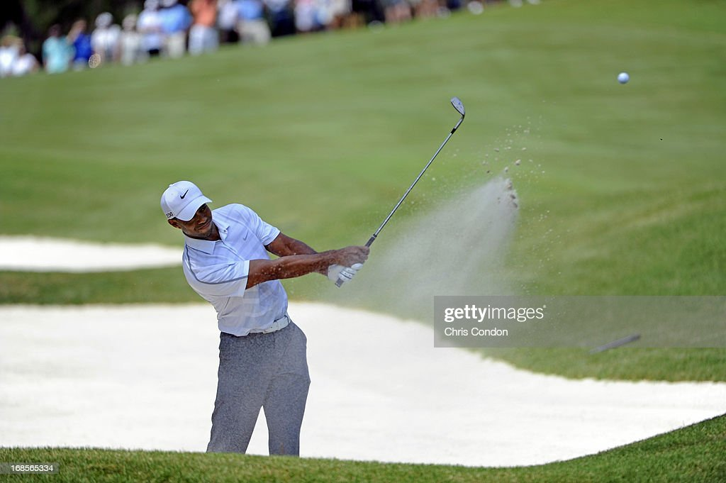 Tiger Woods hits from a bunker on the second green during the third round of THE PLAYERS Championship on THE PLAYERS Stadium Course at TPC Sawgrass on May 11, 2013 in Ponte Vedra Beach, Florida.