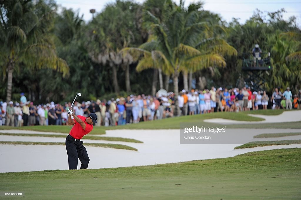 Tiger Woods hits from a fairway bunker on the 11th hole during the final round of the World Golf Championships-Cadillac Championship at TPC Blue Monster at Doral on March 10, 2013 in Doral, Florida.