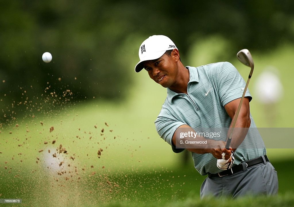 Tiger Woods hits from the bunker on the second hole during the first round of BMW Championship the third event of the new PGA TOUR Playoffs for the...