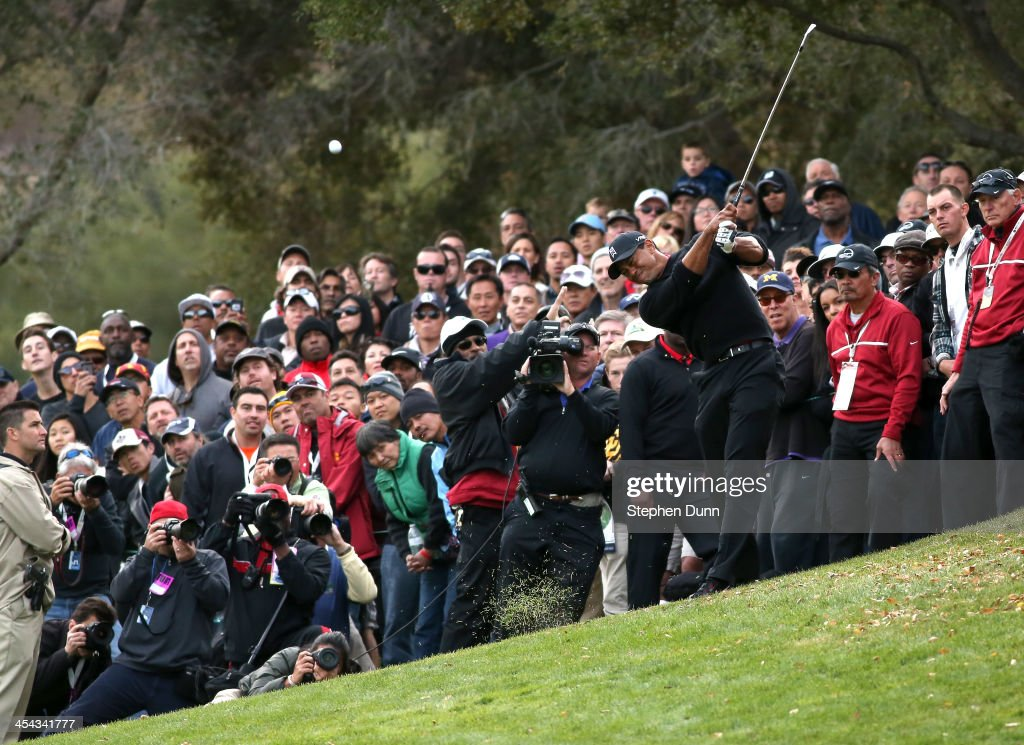 Tiger Woods hits from the rough on the 18th hole during the final round of the Northwestern Mutual World Challenge at Sherwood Country Club on December 8, 2013 in Thousand Oaks, California.