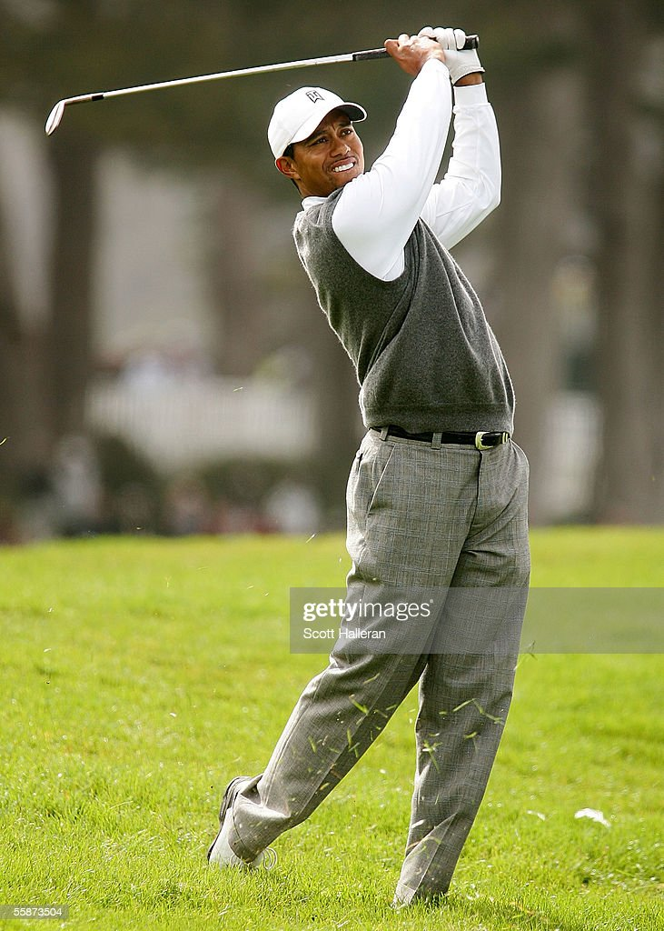 Tiger Woods hits his approach shot on the 18th hole during the second round of the WGC American Express Championship at Harding Park Golf Course on...