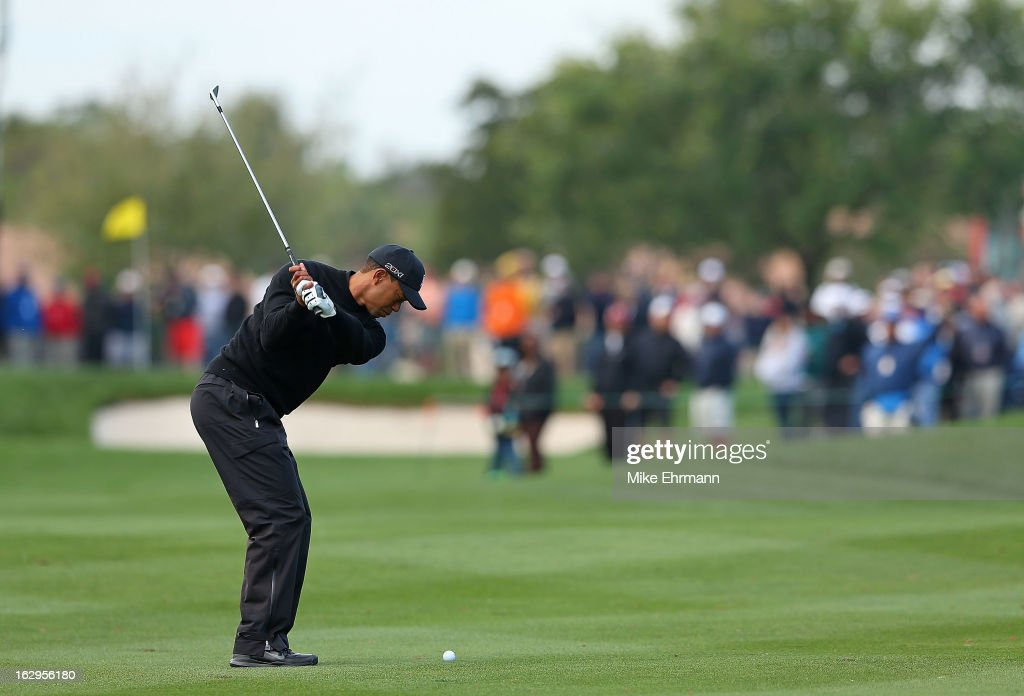 Tiger Woods hits his approach shot on the fourth hole during the third round of the Honda Classic at PGA National Resort and Spa on March 2, 2013 in Palm Beach Gardens, Florida.