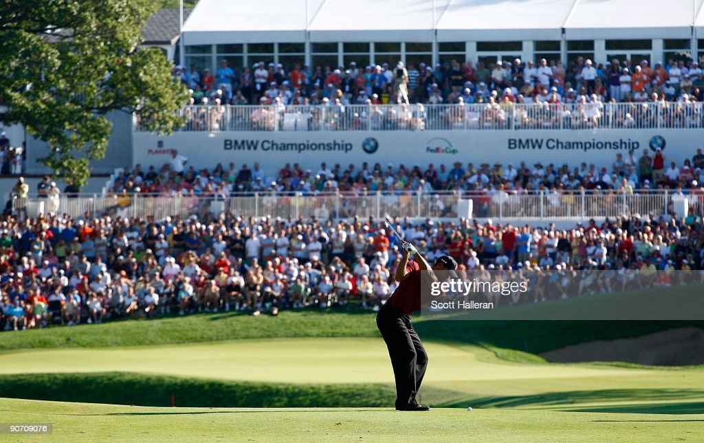 Tiger Woods hits his approach shot to the 18th green during the final round of the BMW Championship held at Cog Hill Golf CC on September 13 2009 in...