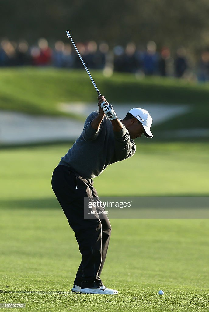 Tiger Woods hits his second shot from the fifth fairway during the final round of the Farmers Insurance Open at at Torrey Pines South Golf Course on January 27, 2013 in La Jolla, California.