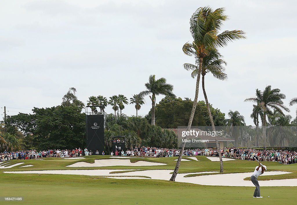 <a gi-track='captionPersonalityLinkClicked' href=/galleries/search?phrase=Tiger+Woods&family=editorial&specificpeople=157537 ng-click='$event.stopPropagation()'>Tiger Woods</a> hits his second shot on the 11th hole during the third round of the World Golf Championships-Cadillac Championship at the Trump Doral Golf Resort & Spa on March 9, 2013 in Doral, Florida.