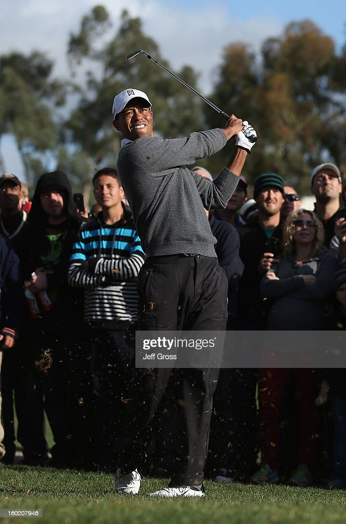 Tiger Woods hits his second shot on the first hole during the final round of the Farmers Insurance Open at at Torrey Pines South Golf Course on January 27, 2013 in La Jolla, California.