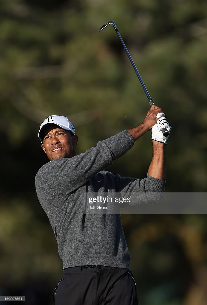 Tiger Woods hits his second shot on the second hole during the final round of the Farmers Insurance Open at at Torrey Pines South Golf Course on January 27, 2013 in La Jolla, California.