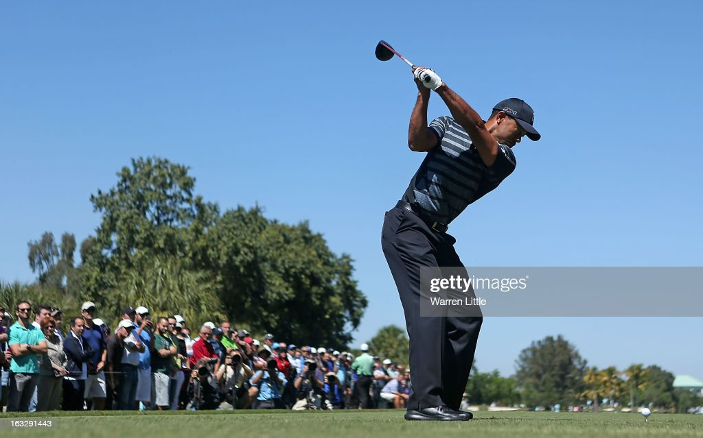 Tiger Woods hits his tee shot on the 12th hole during the first round of the WGC-Cadillac Championship at the Trump Doral Golf Resort & Spa in Miami, Florida.
