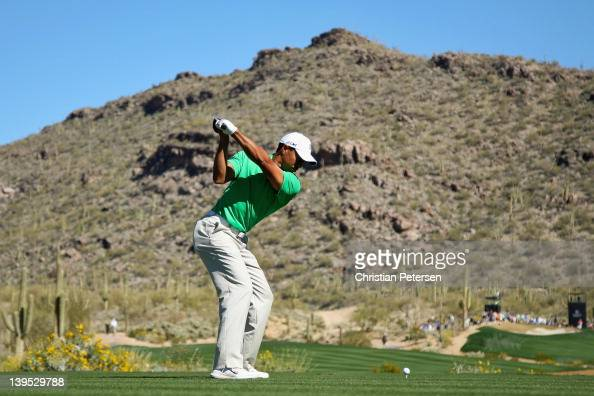Tiger Woods hits his tee shot on the 15th hole during the first round of the World Golf ChampionshipsAccenture Match Play Championship at the...