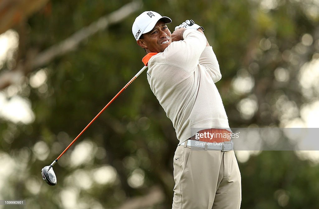 Tiger Woods hits his tee shot on the 15th hole during the first round of the Farmers Insurance Open on the South Course at Torrey Pines Golf Course on January 24, 2013 in La Jolla, California.