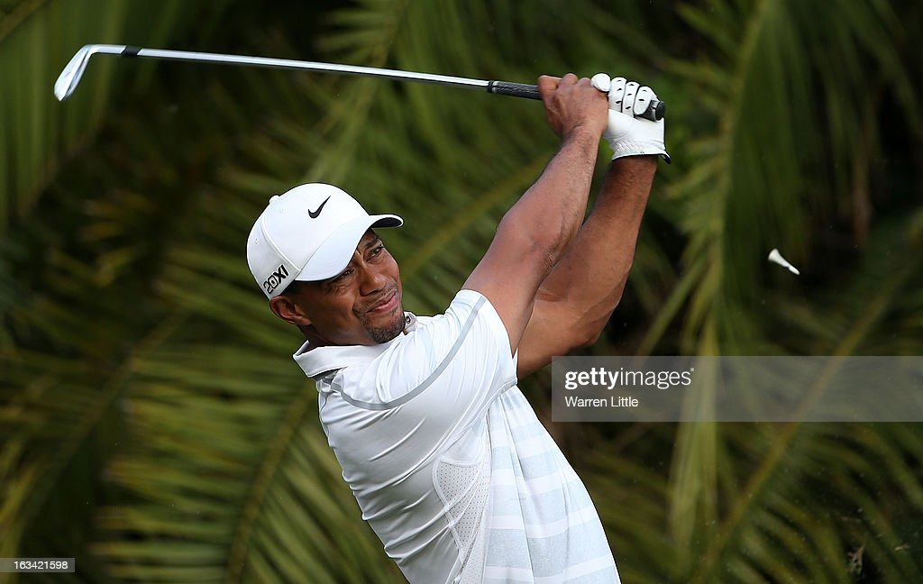 <a gi-track='captionPersonalityLinkClicked' href=/galleries/search?phrase=Tiger+Woods&family=editorial&specificpeople=157537 ng-click='$event.stopPropagation()'>Tiger Woods</a> hits his tee shot on the 15th hole during the third round of the World Golf Championships-Cadillac Championship at the Trump Doral Golf Resort & Spa on March 9, 2013 in Doral, Florida.