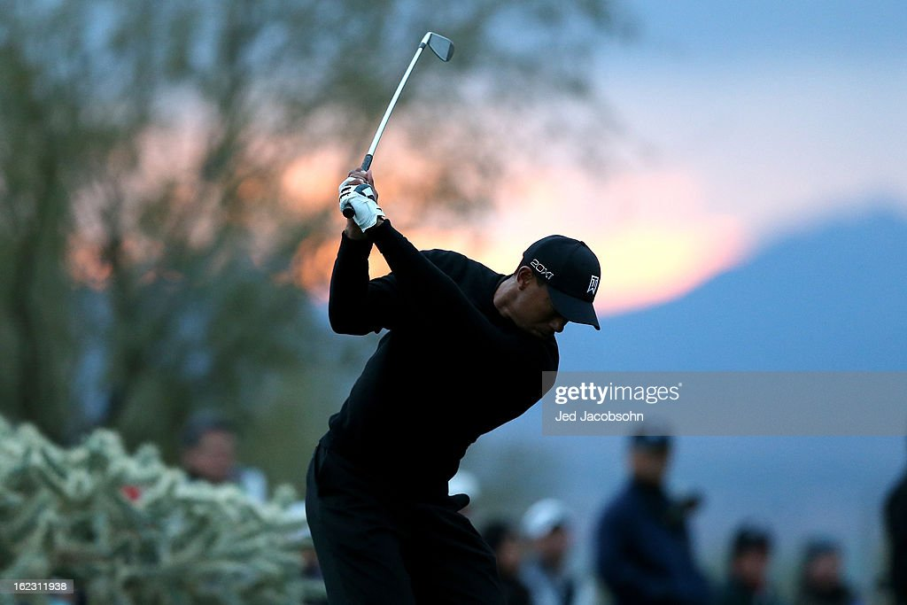 Tiger Woods hits his tee shot on the 16th hole during the first round of the World Golf Championships - Accenture Match Play at the Golf Club at Dove Mountain on February 21, 2013 in Marana, Arizona. Round one play was suspended on February 20 due to inclimate weather and is scheduled to be continued today.