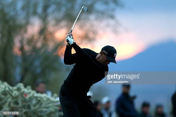 Tiger Woods hits his tee shot on the 16th hole during the first round of the World Golf Championships Accenture Match Play at the Golf Club at Dove...