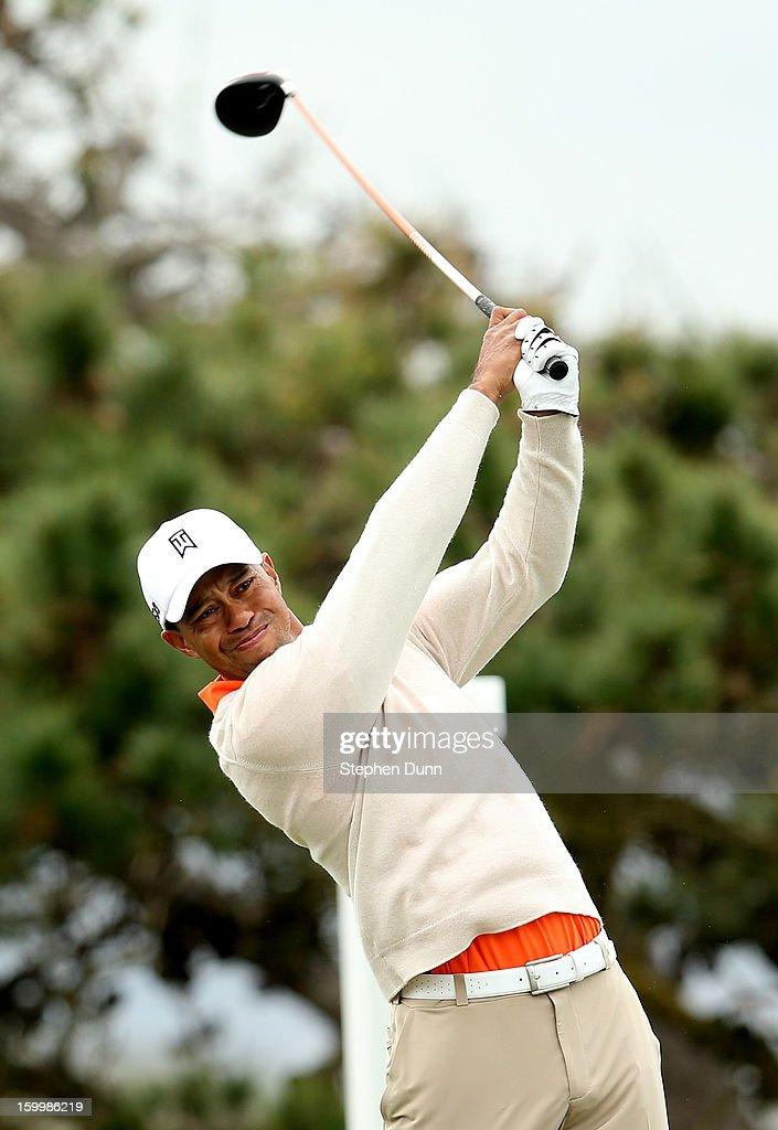 Tiger Woods hits his tee shot on the fourth hole during the first round of the Farmers Insurance Open on the South Course at Torrey Pines Golf Course on January 24, 2013 in La Jolla, California.