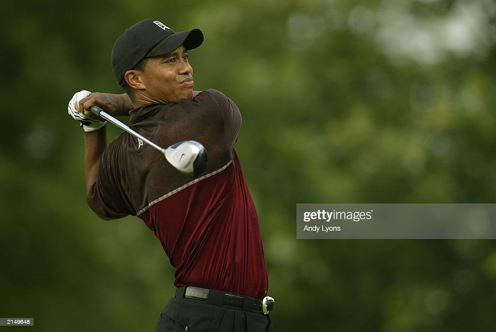 Tiger Woods hits his tee shot on the par 4 18th hole during the final round of the Western Open on July 6 2003 at Cog Hill Golf and Country Club in...